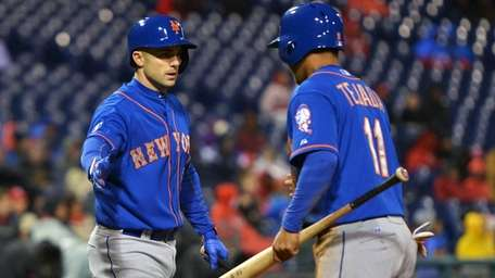 Ruben Tejada of the Mets is congratulated by