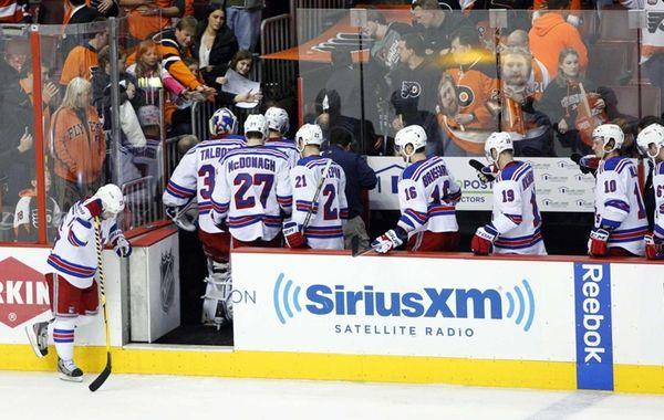 Rangers' Martin St. Louis, left, hangs his head