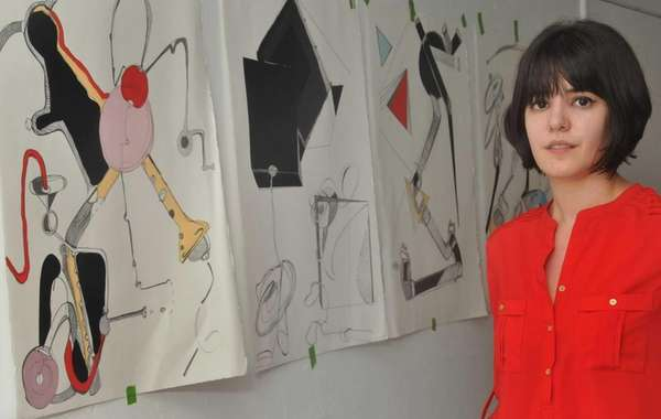 Artist Michelle Carollo, shown here with projects she
