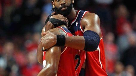 Nene of the Washington Wizards hugs teammate John