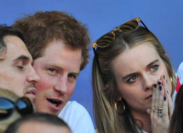 Britain's Prince Harry and then-girlfriend Cressida Bonas watching