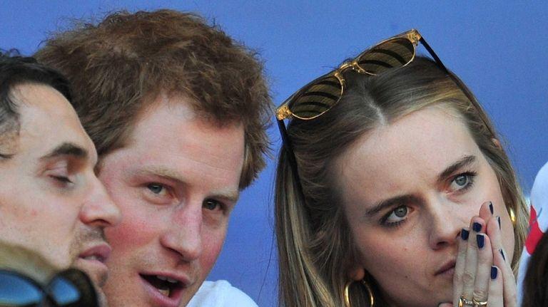 Britain's Prince Harry and then-girlfriend Cressida Bonas watching