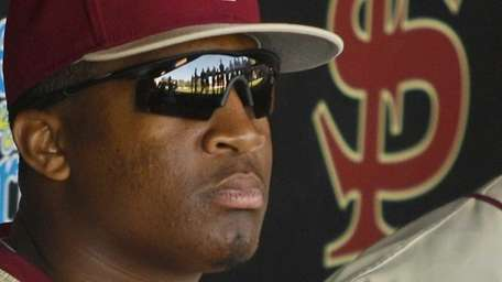 Florida State relief pitcher Jameis Winston sits in