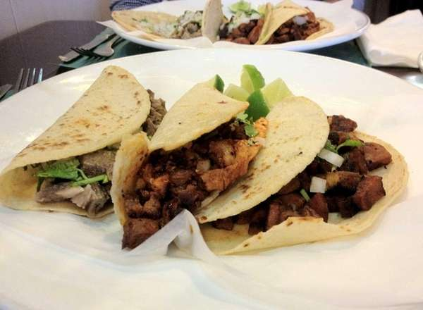 Tacos of lengua (tongue), pork (pastor) and chorizo