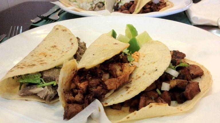 Tacos of lengua (tongue), pork (pastor) and chorizo