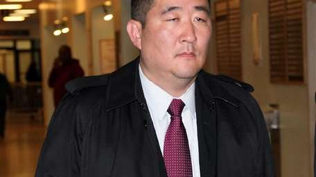 Kewho Min, one of the 104 arrests made