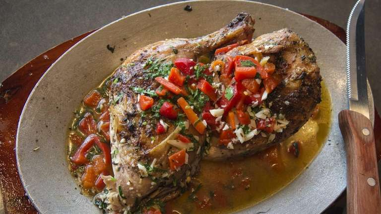 The half roasted chicken, marinated in lime, garlic