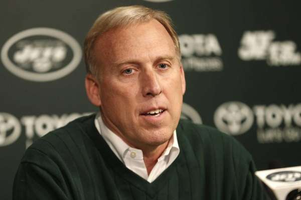 John Idzik talks during a news conference ahead