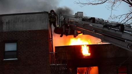 Firefighters fight the blaze which started at 6:20