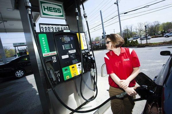 Megan Vilar gets gas on her way to