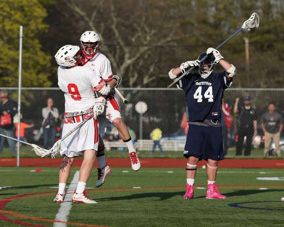 Smithtown East's Joe Saggese celebrates with Tom Marino