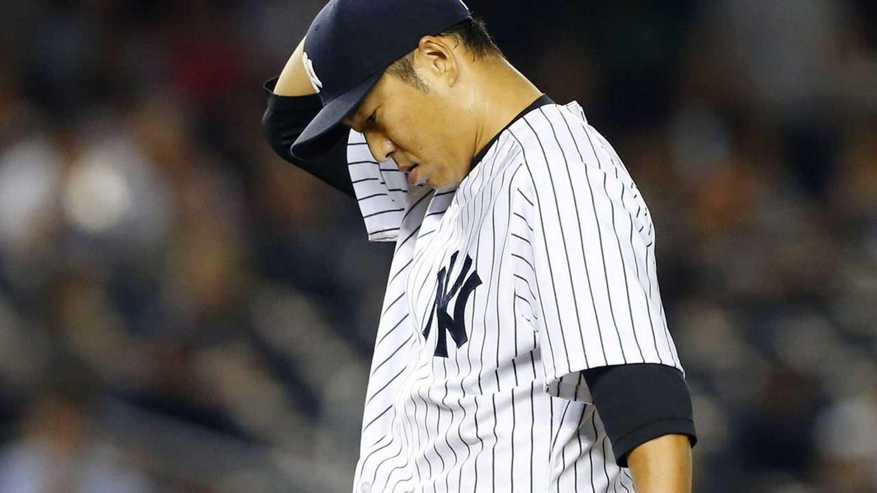 Hiroki Kuroda of the Yankees stands on the