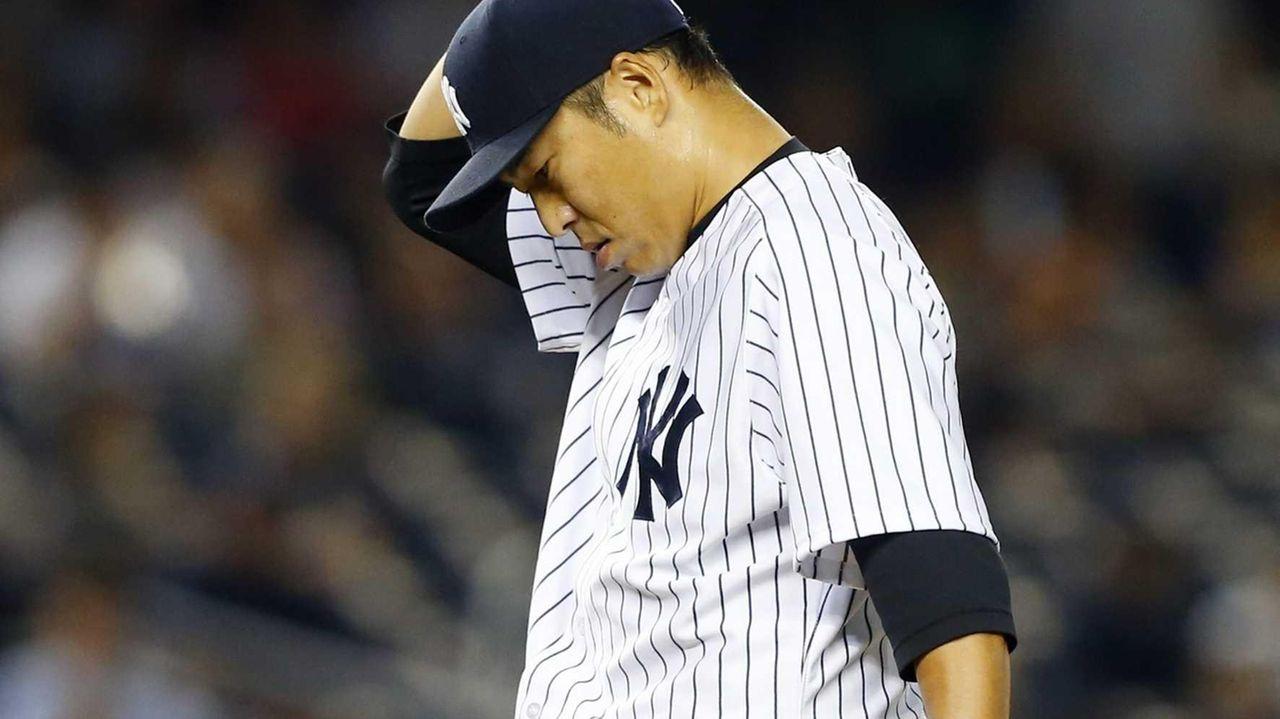 Hiroki Kuroda of the Yankees stands on the