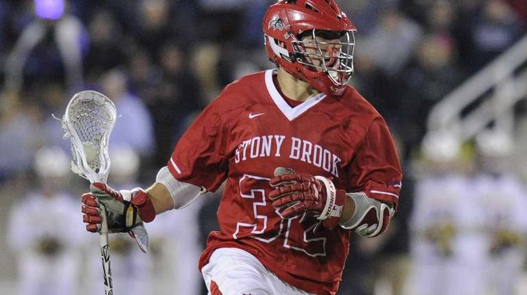 Stony Brook midfielder Mike Andreassi controls the ball