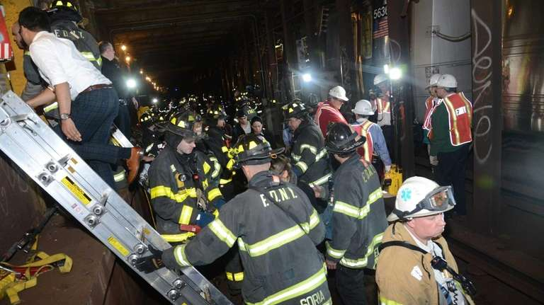 Emergency service workers help passengers after an F