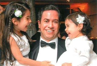 Seth Skolnik with his daughters, Sophie, left, and