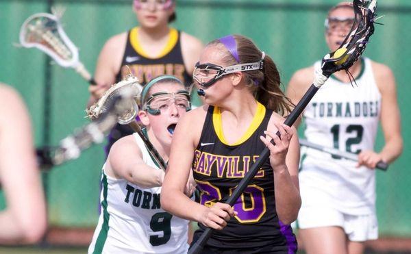 Sayville's Kelly Marra looks to pass. (May, 2,