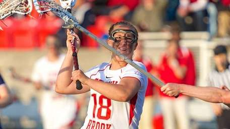 Stony Brook attacker Courtney Murphy drives to the