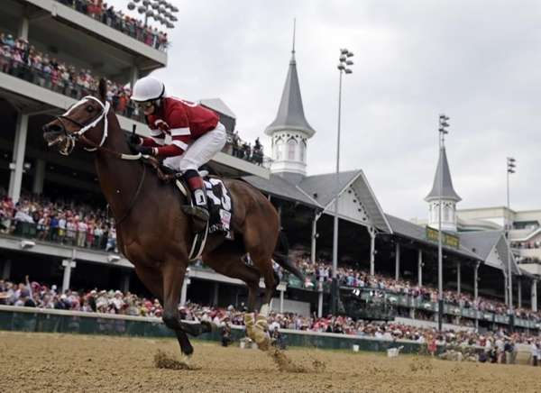 Rosie Napravnik rides Untapable to victory during the