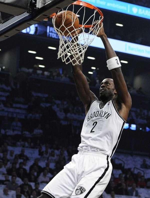 Nets forward Kevin Garnett dunks against the Toronto