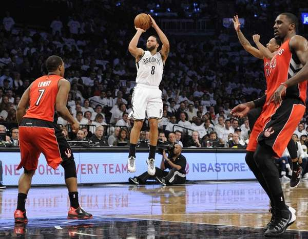 Nets guard Deron Williams scores against the Toronto