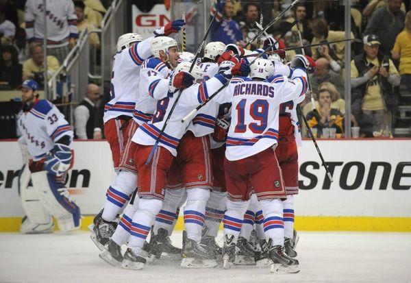 The Rangers mob Derick Brassard after his game-winning