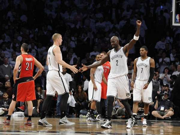 Nets forward Kevin Garnett reacts with forward/center Mason