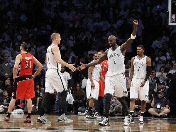 Nets forward Kevin Garnett reacts with forward/center Mason