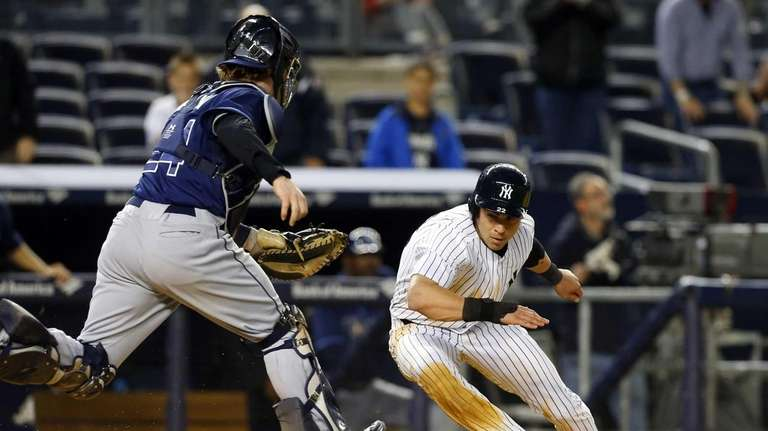 Jacoby Ellsbury of the Yankees is tagged out