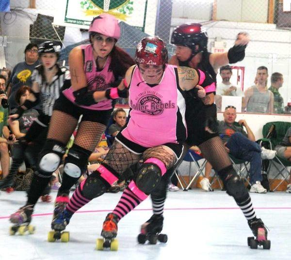 Members of the Long Island Roller Rebels skate