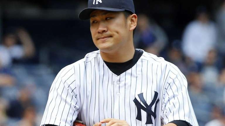 Masahiro Tanaka of the Yankees looks on in
