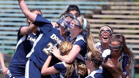Dowling players celebrate after beating LIU Post in
