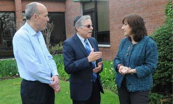 Rabbi Steven Moss, center, talks to Rabbi Susie