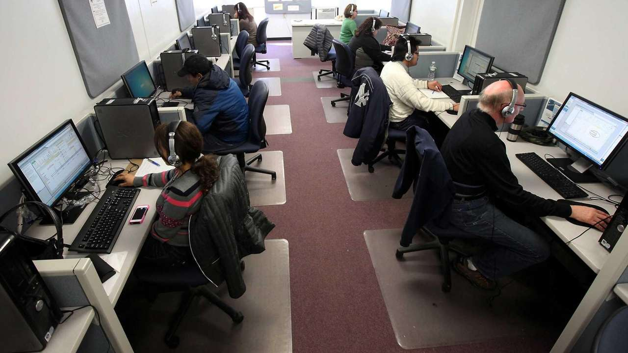 Job hunters use computers on March 21, 2014,