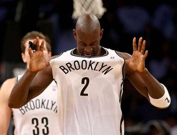 Kevin Garnett of the Nets celebrates in the