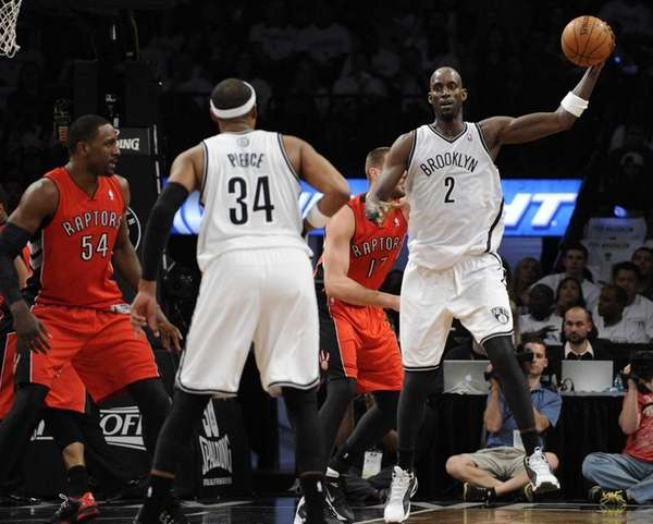 Nets forward Kevin Garnett looks to pass to