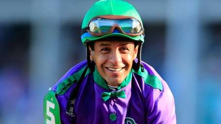 Jockey Victor Espinoza smiles atop of California Chrome