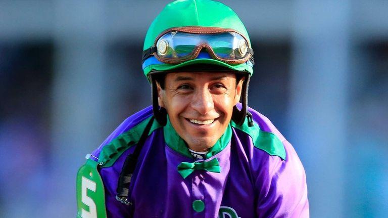 Jockey Victor Espinoza smiles atop of California Chrome
