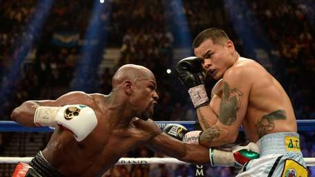 Floyd Mayweather Jr. throws a left at Marcos