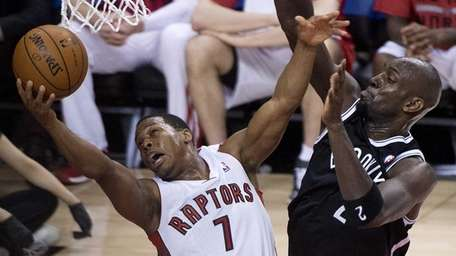 Toronto Raptors guard Kyle Lowry (7) gets fouled