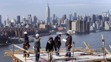 In this Nov. 12, 2008 file photo, carpenters