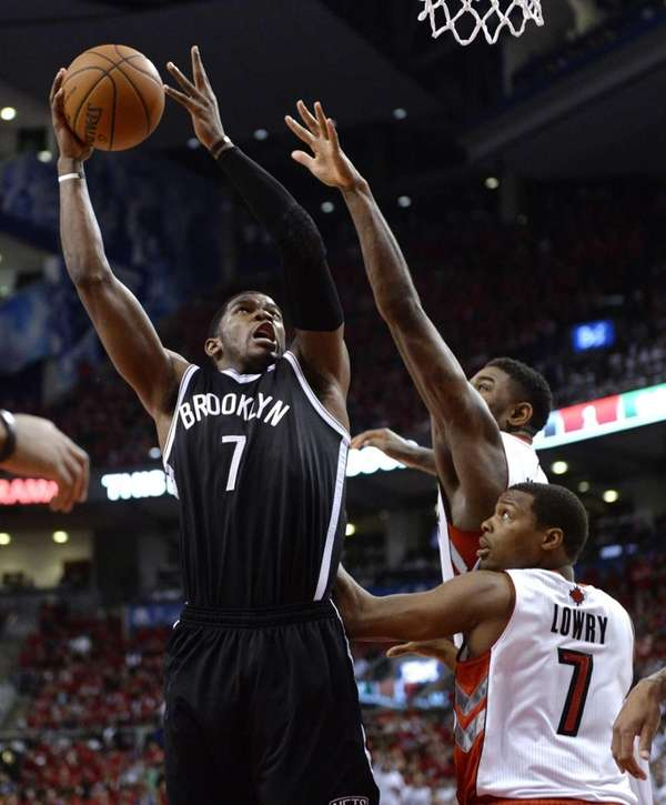 Joe Johnson, left, shoots over the Toronto Raptors'