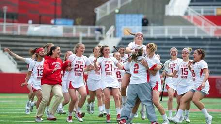 Stony Brook storms the field after securing the