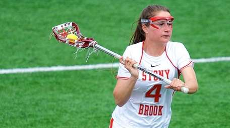 Stony Brook midfielder Amber Kupres (4) makes a