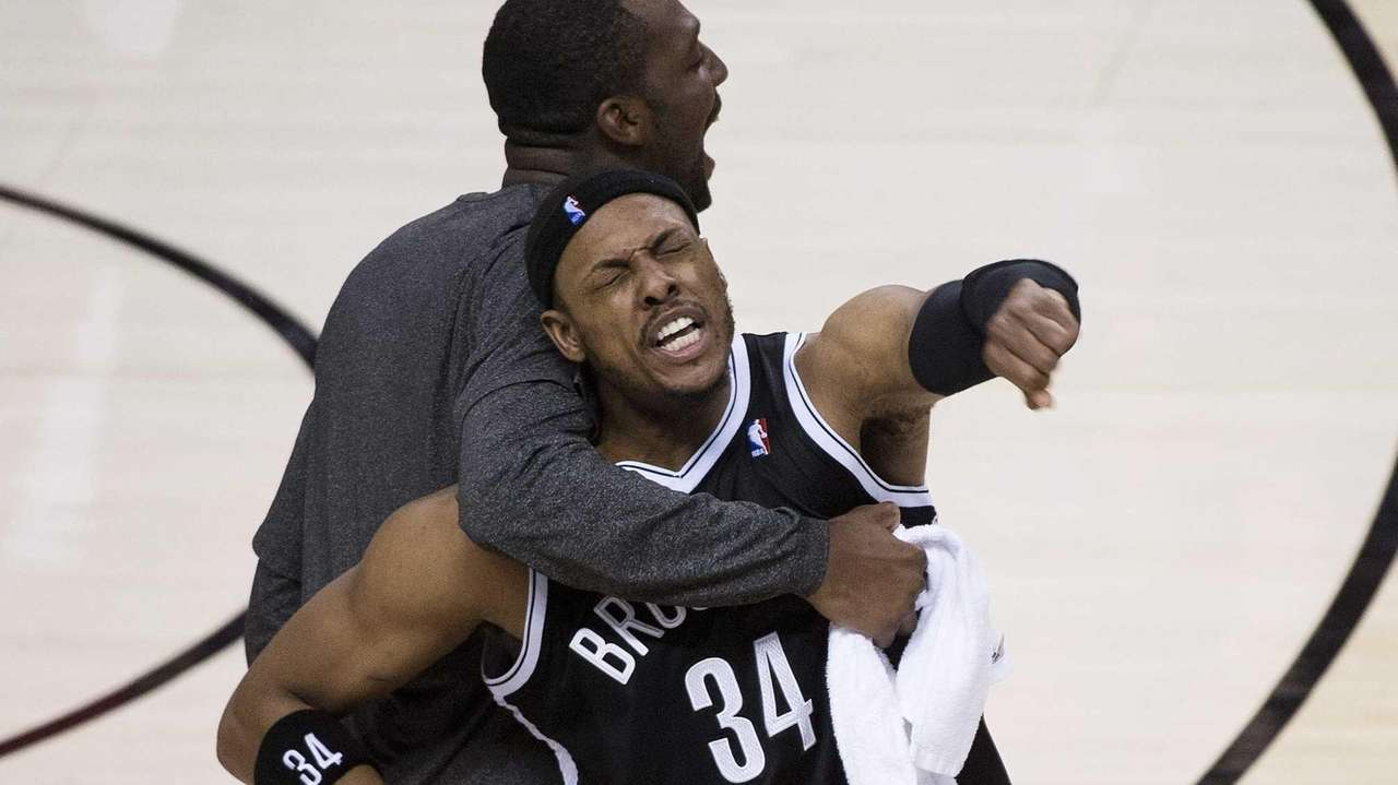 Paul Pierce (34) reacts with teammate Andray Blatche,