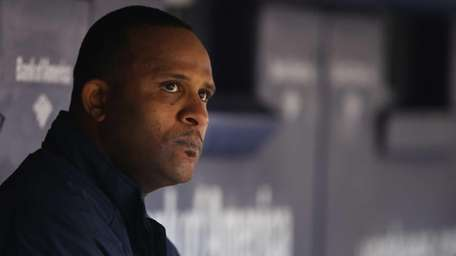 CC Sabathia sits in the dugout after being