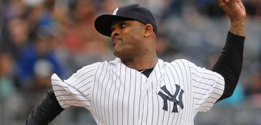 CC Sabathia delivers to the plate during the