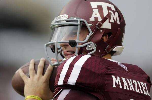 Texas A&M quarterback Johnny Manziel throws a pass