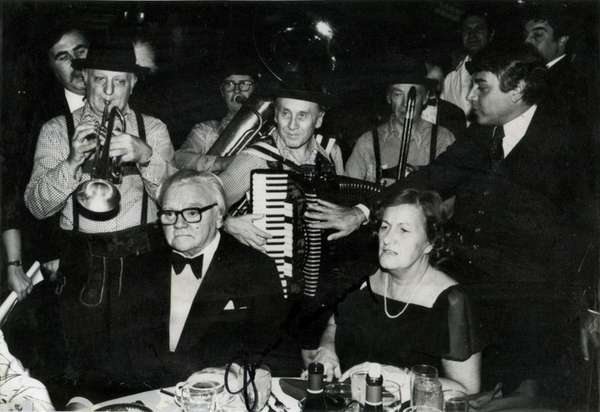 Henry Golis Sr., left, playing trumpet with actor
