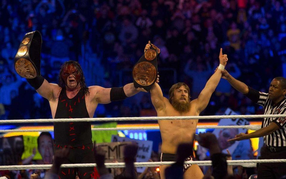 WWE Superstar Daniel Bryan, right, celebrates with Team